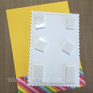 """Use a foam adhesive (X-Press It 1/2"""" Foam Tape used here) to """"pop"""" the focal image layer up on the card front."""